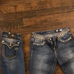 Two pair size 29 miss me jeans.  Boot cut